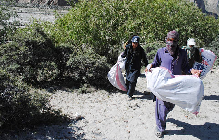 Carrying waste near Joula Camp