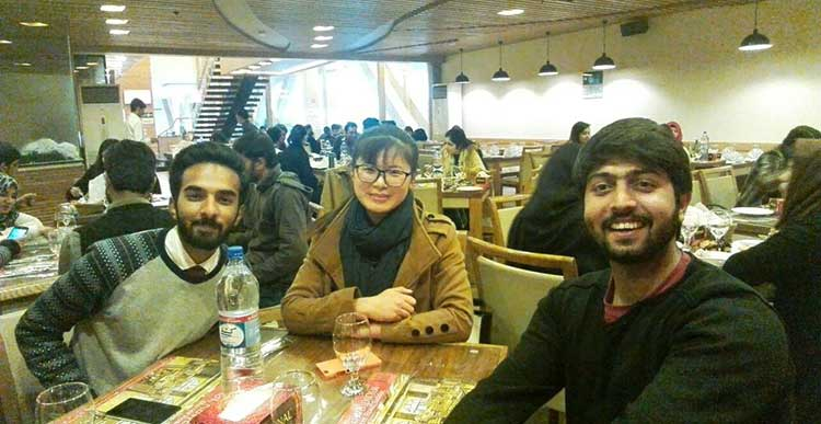 How Two Chinese Students Spent Their New Year in Pakistan: Grace dining out with friends in Islamabad
