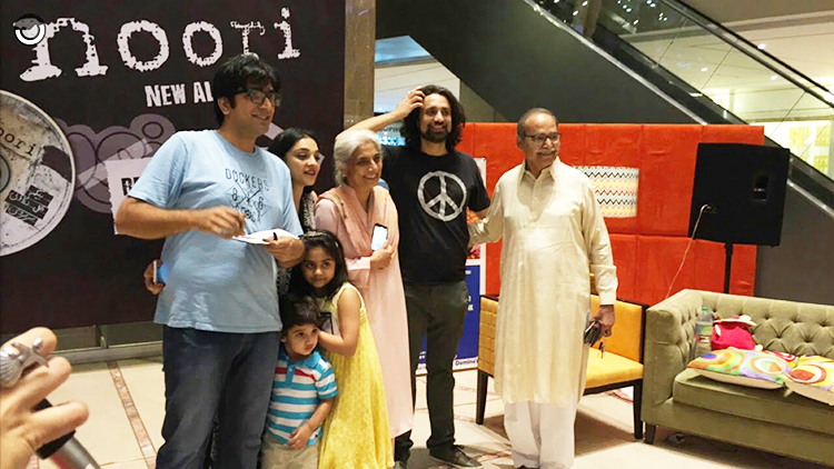 Ali Noor and Ali Hamza with their parents