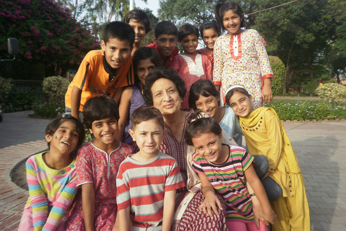 Soraya Anwar, head of SOS Lahore, with the children - S.O.S. VILLAGE: SAVING SOULS