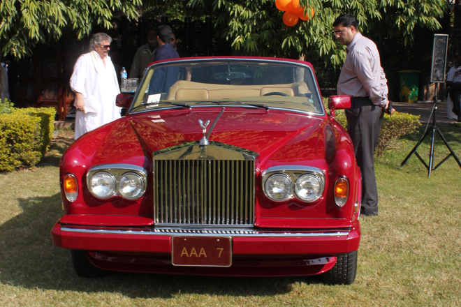 A shimmering two-door Rolls-Royce with its owner