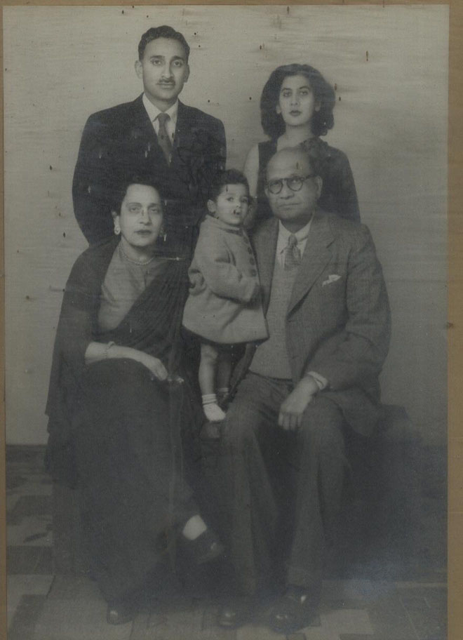 Col and Mrs. Rehman with little Shaheen, General and Mrs. Atiqur Rehman standing