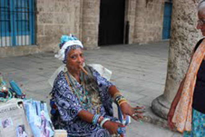 A palmist in Plaza de la Catedral