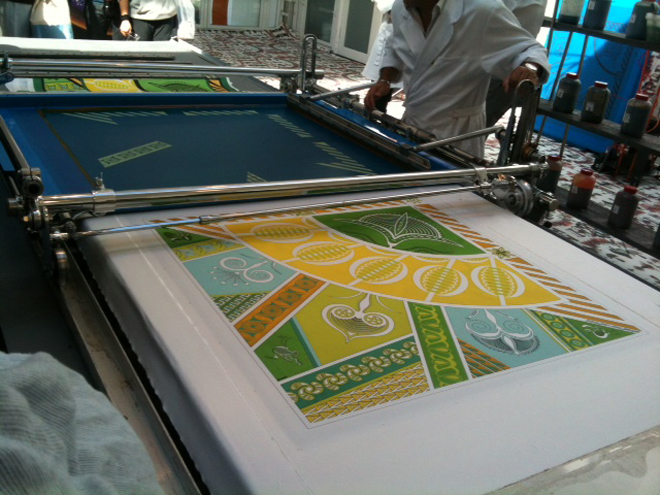 Demonstration of screen printing on silk Hermes scarf