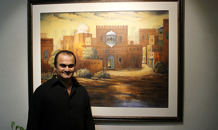 Veteran artist G. N. Kazi stands next to one of his masterpieces - Architectural Paintings Exhibition at Nomad Gallery