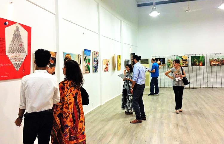 Visitors at the 'Bastille to Karachi Jail' exhibition - Art by Prisoners of Centeral Jail Karachi at Alliance française de