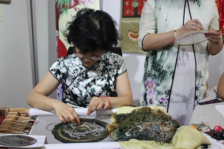 Ms. Yu Zhiyin doing embroidery