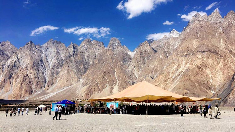 Passu Cones in the background, FACE Mela in the foreground - FACE Mela 2017 at Village Passu