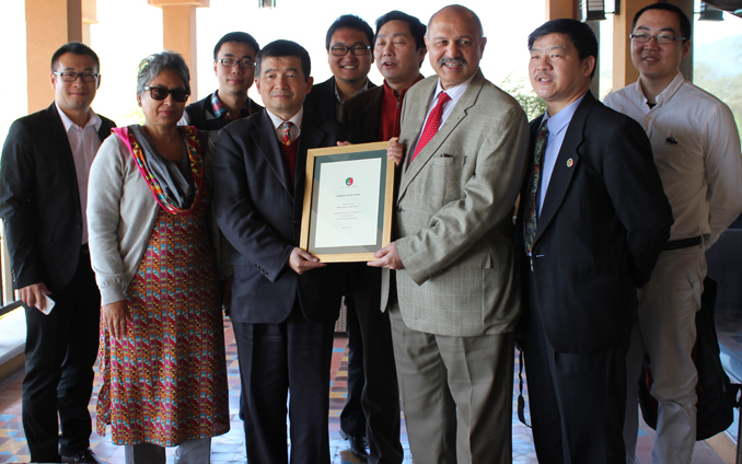 Senator Mushahid and Dr Dushka H. Saiyid (Editor Youlin) presenting Prof. Zhou with a Certificate of Merit - Farewell to Professor Zhou Rong