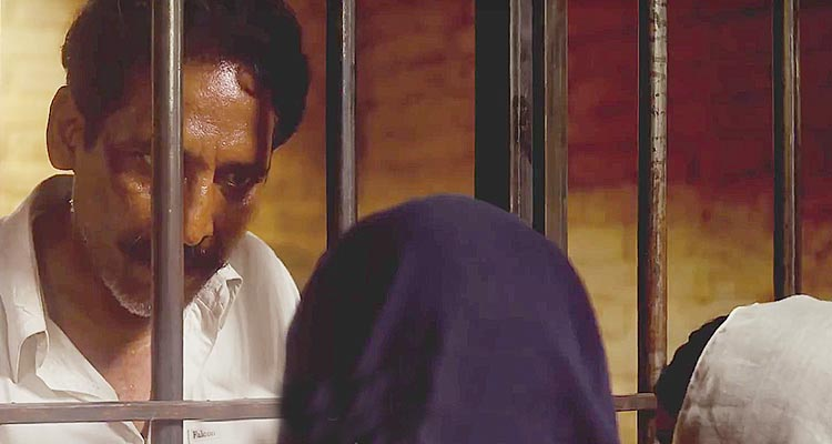 Syed Tanveer Hussain as Baba, talks to his daughters from behind bars - Film My Pure Land