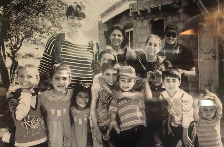 Elizabeth Kanaan with friends and children of Altit Village in Hunza Valley - From San Francisco to Hunza