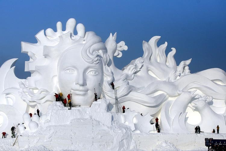 Artists carve an ice sculpture at the Ice and Snow Cultural Expo (source: Reuters) - Harbin: A Summer Ice City
