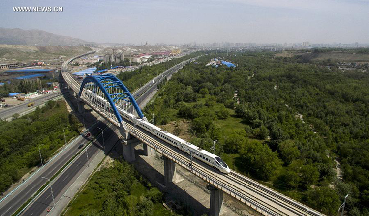 An aerial view of the Lan-Xin High-Speed Railway - High Speed Rails in Xinjiang, China
