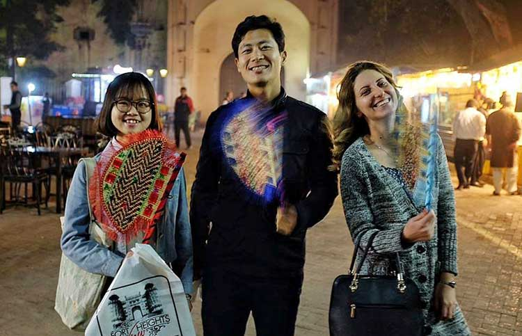 Chen Yanni (left) at the Lahore Food Street - How Two Chinese Students Spent Their New Year in Pakistan