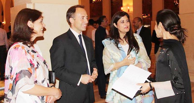 Director Satrang Gallery Asma Rashid Khan greeting the guests at the opening - Hurouf: 6th Annual Calligraphy Show at Satrang Art Gallery
