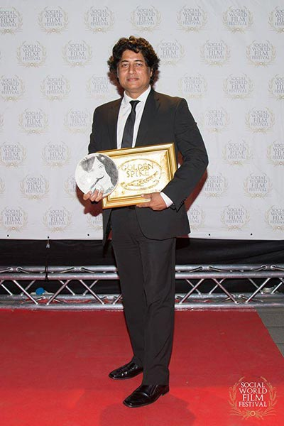 Farhan Alam with the Best Film and Best Director Award, Social World Film Festival 2017, Italy
