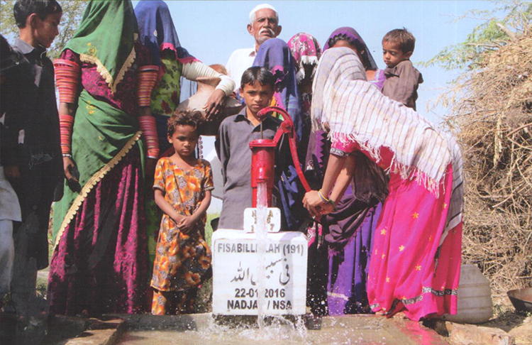 Locals draw water from a newly repaired well in Nagarparkar - Life in Thar Desert