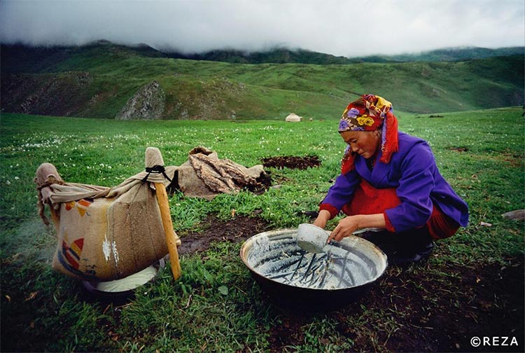 Organic Food of China - On the heights of the Chinese Altai Mountains, a Kazakh woman makes cheese out of cow milk