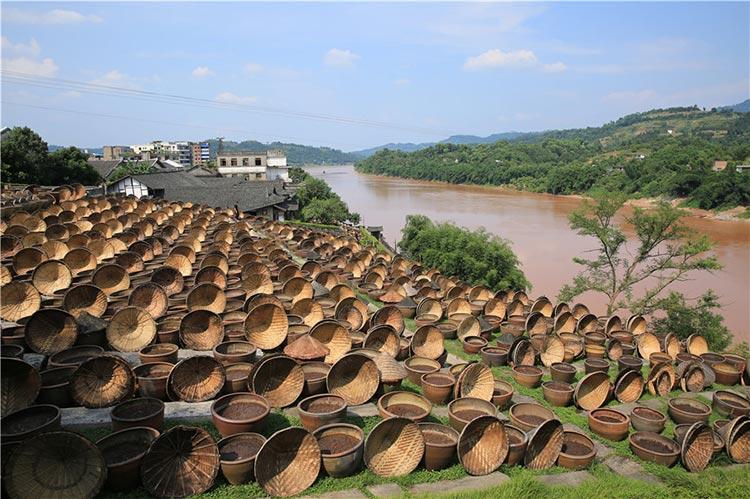 Countless jars of Soy Sauce along the Chishui River in Xianshi (source: China Daily) - Organic Food of China