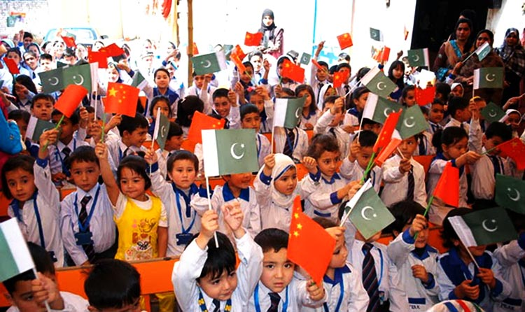 Pakistani school children raise friendship flags for China and Pakistan