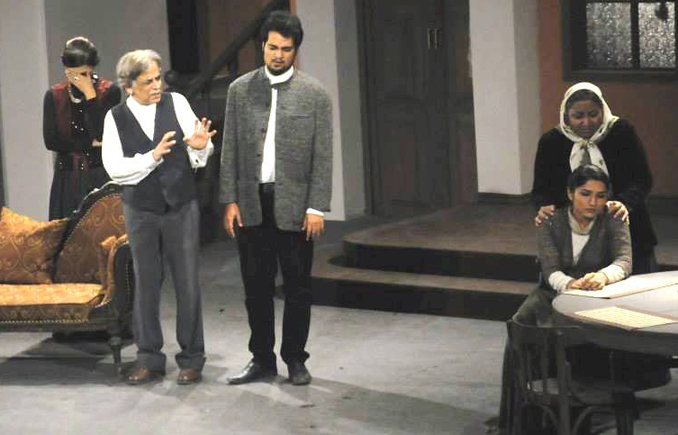 Peter and his father take center stage in the opening scene - Play 'Dhaiti Deewarain' by Zia Mohyeddin