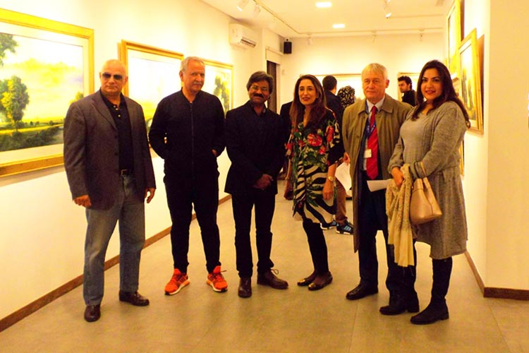 Guests posing for a picture with the artist Zulfiqar Ali Zulfi and the gallery Curator, Noshi Qadir