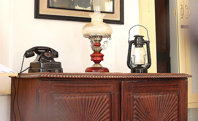 Antique telephone and lamps at TDF Ghar, Karachi