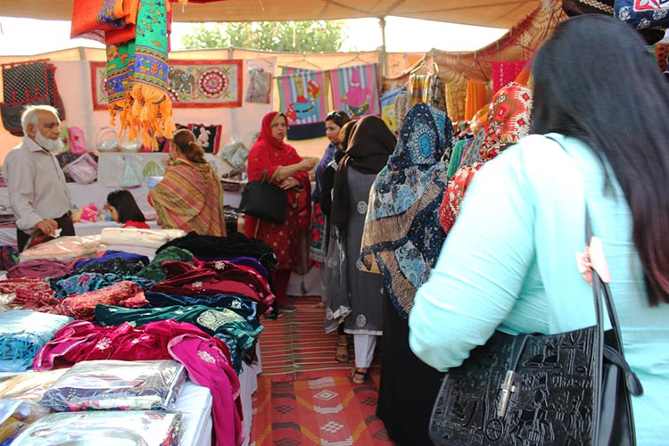 Customers at one of the clothing stalls