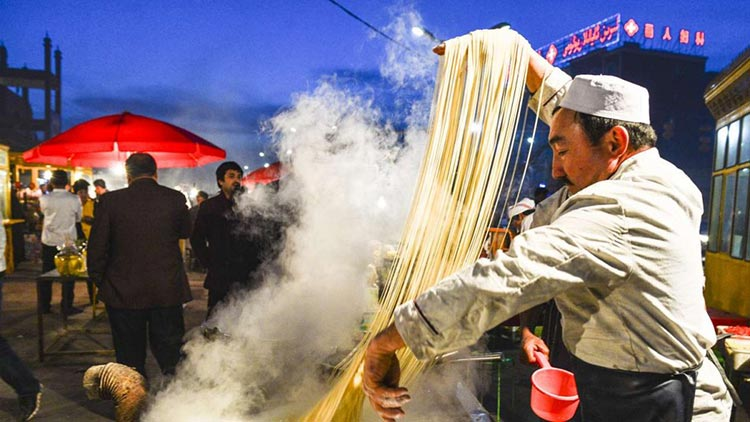 Making hand-pulled noodles (source: South China Morning Post - Xinjiang Noodle