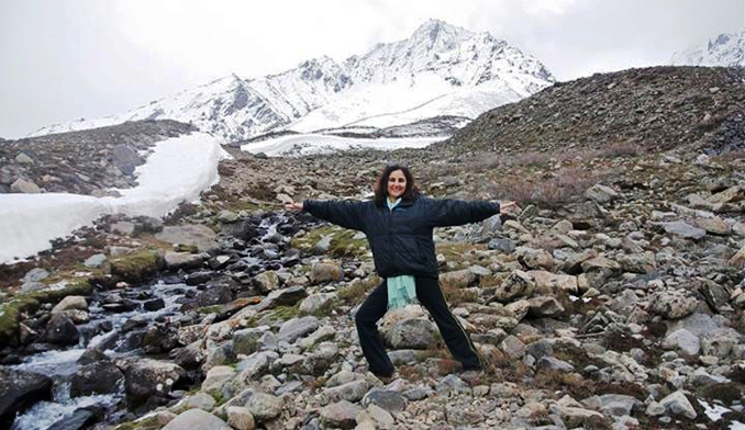 Doing the warrior pose at 13,000 feet above the ground! - YOGA RETREAT IN CHITRAL