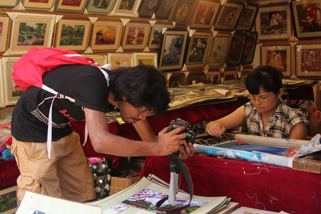 The director capturing intricate Chinese handicrafts in the village of Zhujiajiao