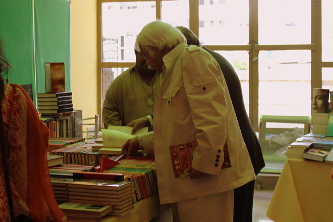 Mazhar-ul-Islam going through the book-stalls